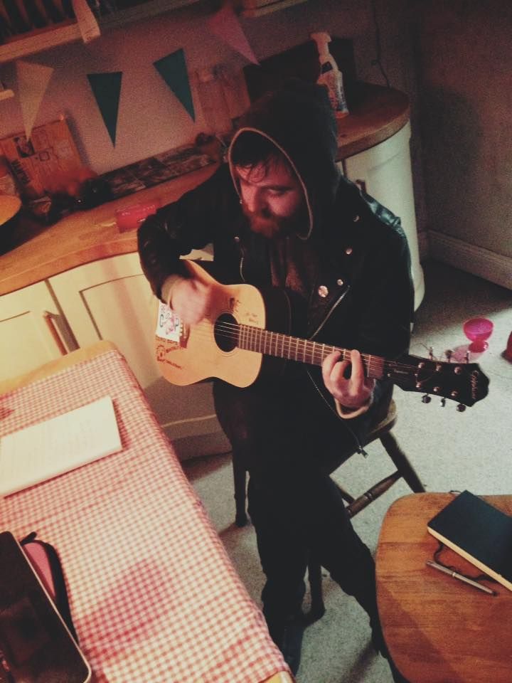 The author looking deep and meaningful as he writes songs in the kitchen.